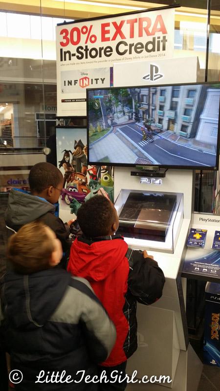 Kids playing PS4 at Gamestop